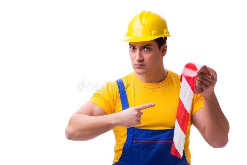 Der tragende Overall der lustigen Arbeitskraft mit Band lizenzfreies stockbild