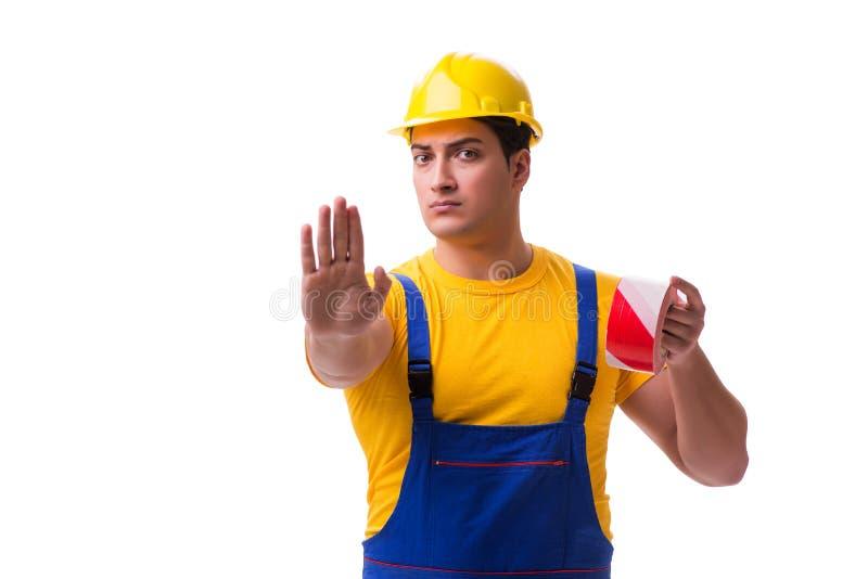 Der tragende Overall der lustigen Arbeitskraft mit Band stockfotografie
