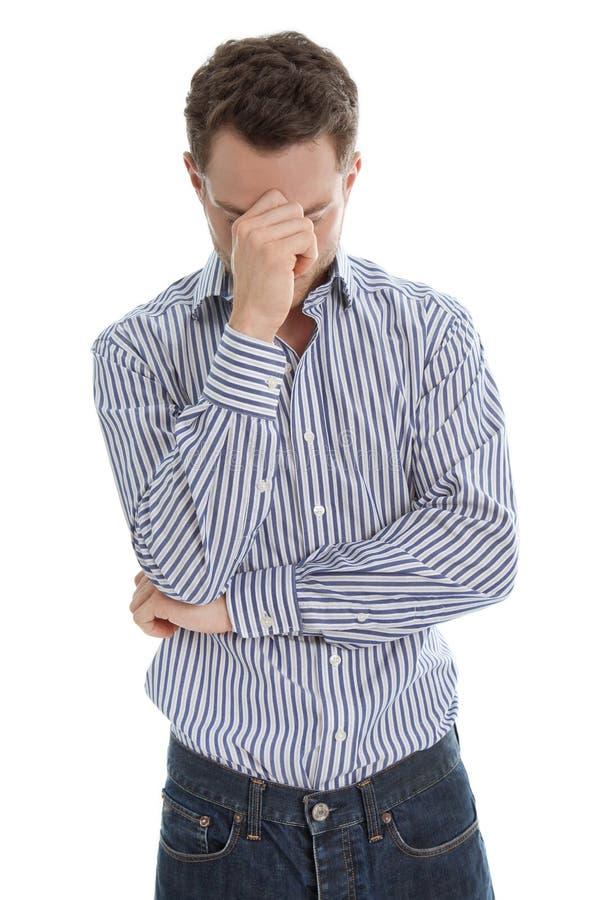 Der traurige Mann, der lokalisiert wird, hat Migräne oder ist deprimierend. stockfotos