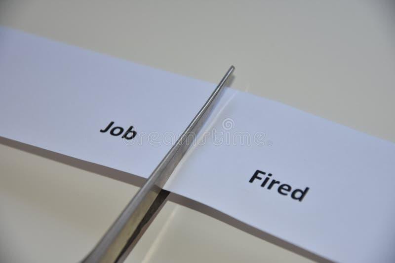 Der Widerspruch zwischen zwei Entscheidungen: Job oder abgefeuert stockfotos