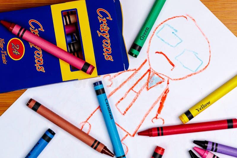 Der Zeichenstift-Zeichnung eines Kindes einer Person mit generischen Zeichenstiften und einem generischen Zeichenstift-Kasten stockfotografie