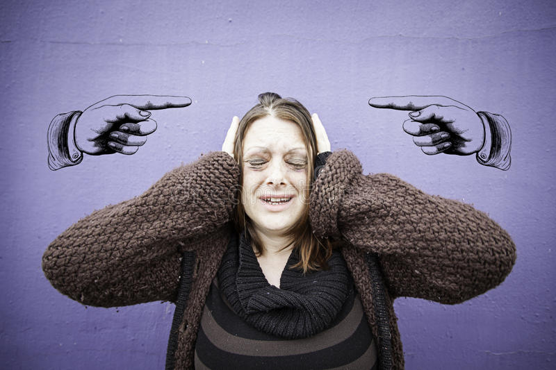 Deranged woman. Deranged and distressed woman in urban street royalty free stock photo