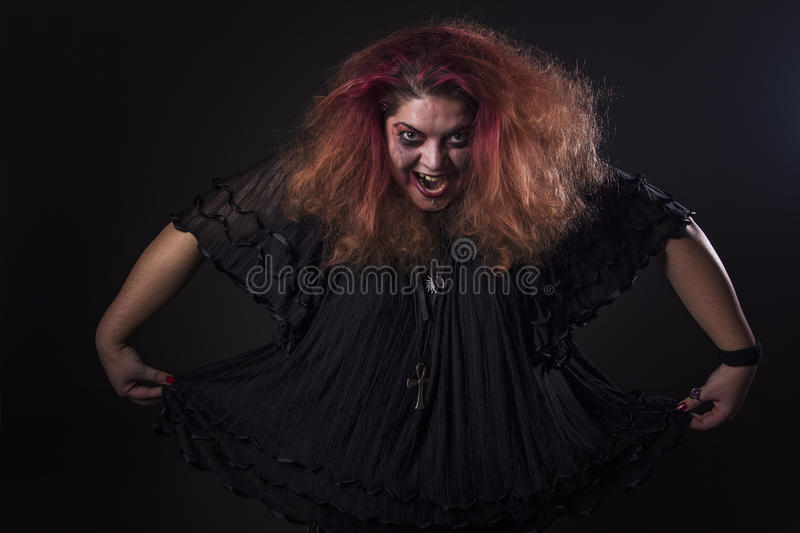 Deranged woman screaming. Mad girl with a dangerous face screaming loudly royalty free stock photography