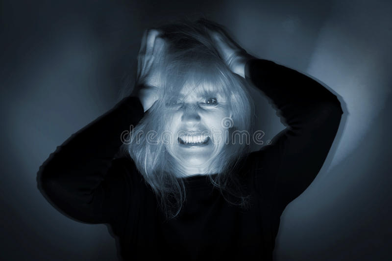 Deranged Woman. Woman undergoing psychotic episode mental health concept with motion blur stock photos