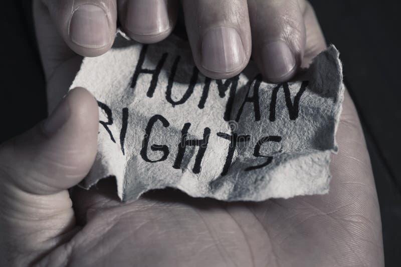 Derechos humanos del texto en un trozo de papel fotografía de archivo libre de regalías