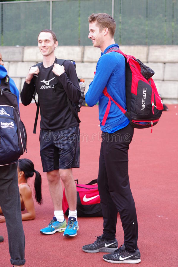 Derek Drouin and Mike Mason, Canadian high jump athletes. Derek Drouin, Canadian record holder of 2.40m in high Jump, talking with his friend Mike Mason, high stock images