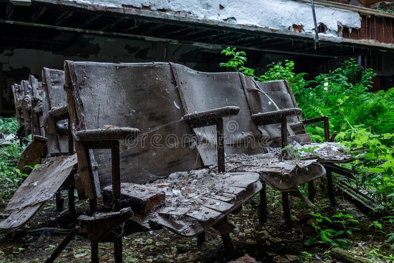 Derelict Auditorium Seats - Abandoned School - New York. A view of derelict auditorium / theater seating in a long abandoned school in New York stock photography