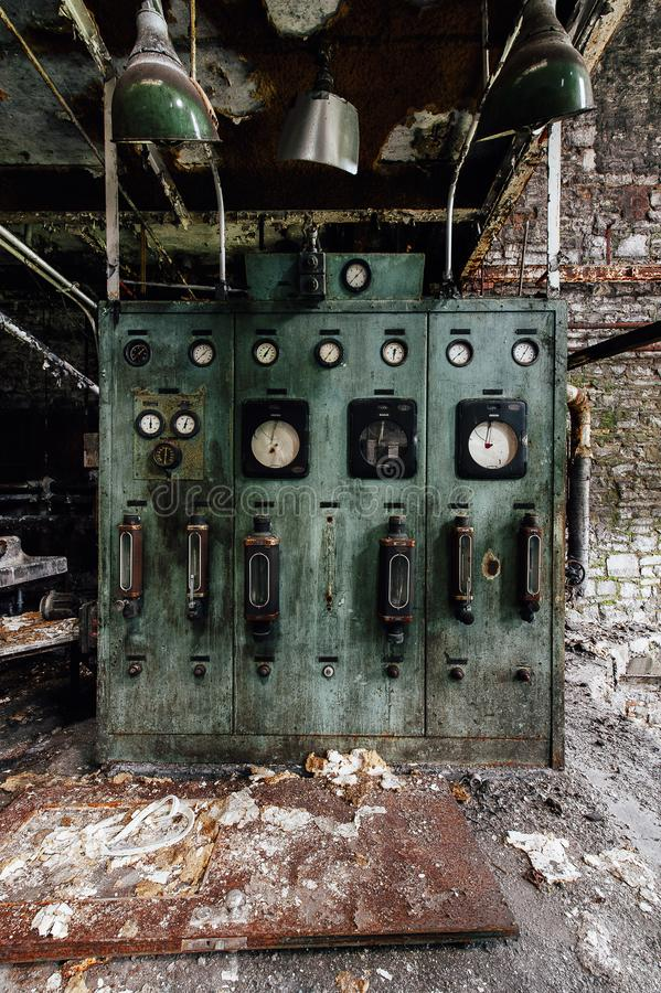 Derelict Control Panel - Abandoned Old Crow Distillery - Kentucky. A view of a derelict and grimy control panel at the abandoned Old Crow Distillery in Kentucky royalty free stock image