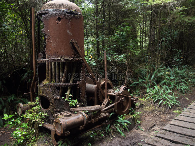 Derelict Donkey. Steam powered derelict donkey located along the west coast trail on Vancouver Island British Columbia, Canada stock photography