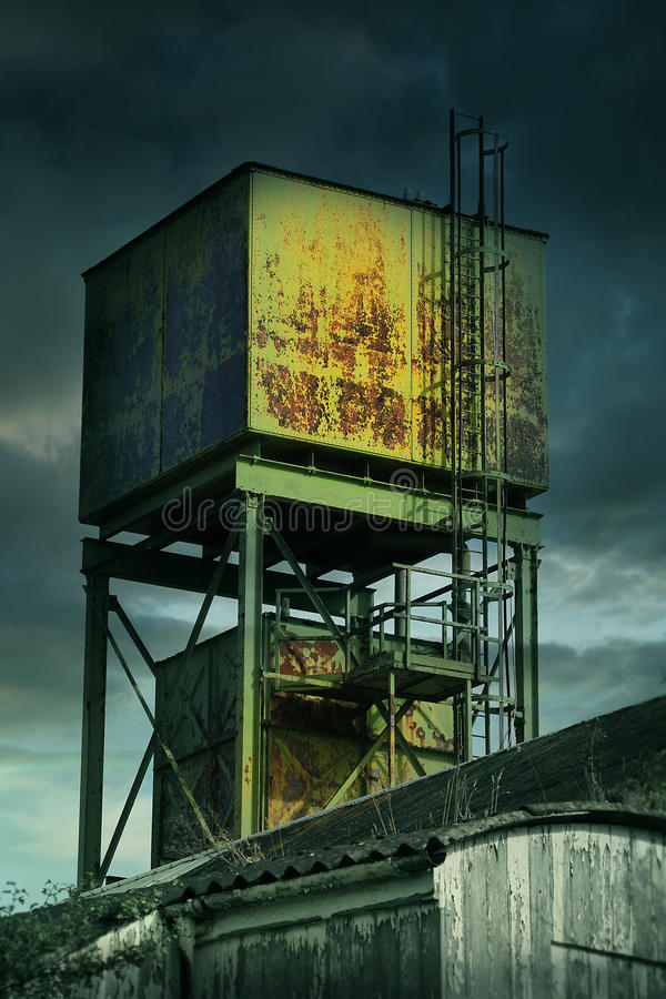 Derelict factory tower stock image