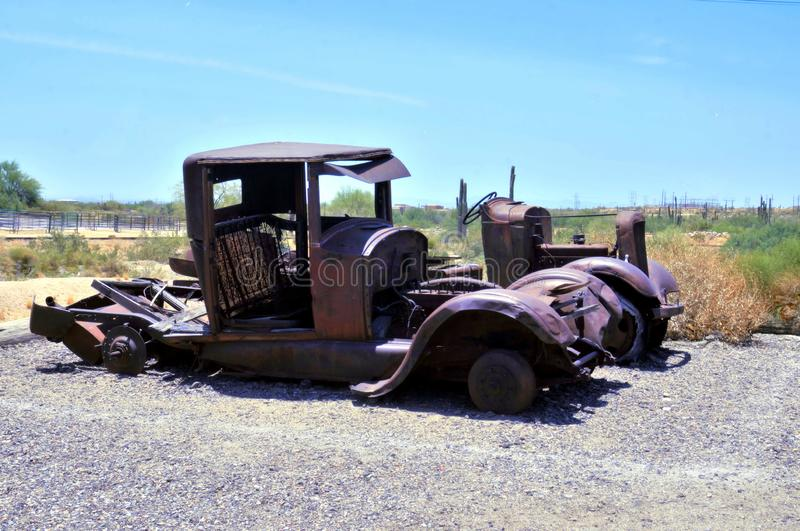 Relics Of A Bygone Era At Goldfield, Arizona. The derelict Ford Model A and the other abandoned car beside it are relics of a bygone motoring era in the 1930`s stock image