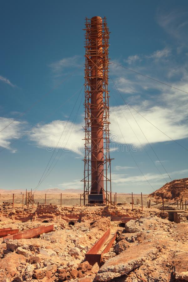 Derelict and industrial rusting chimney at the historic Humberstone saltpeter in the Atacama desert near Iquique, northern Chile royalty free stock photos
