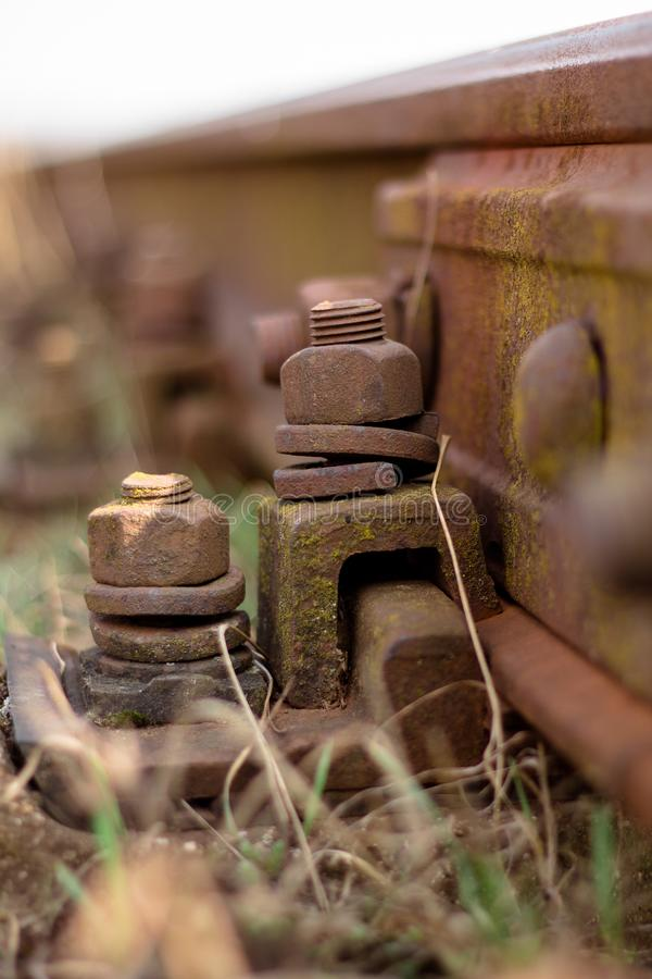 Derelict railway, rusty bolt with nut. Rusty railway track stock photography
