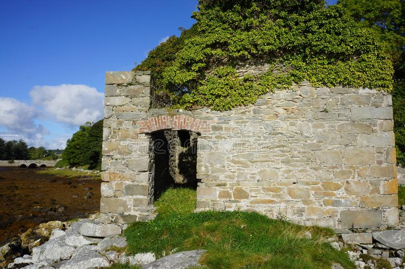 Derelict stone building at Ray bridge. This picture is of an old derelict stone building on the shore line beside Ray Bridge which is between the towns of royalty free stock photography