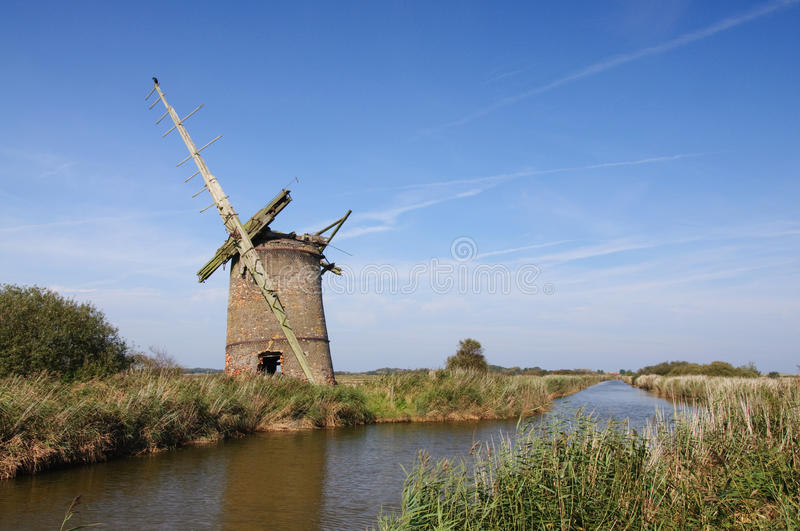 Derelict drainage windmill on Norfolk Broads royalty free stock photos