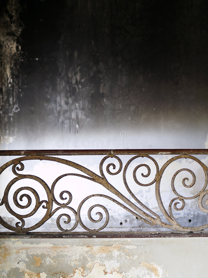 Dereliction. Ornate wrought iron railing of a burnt down mansion which once home to royalty stock photos