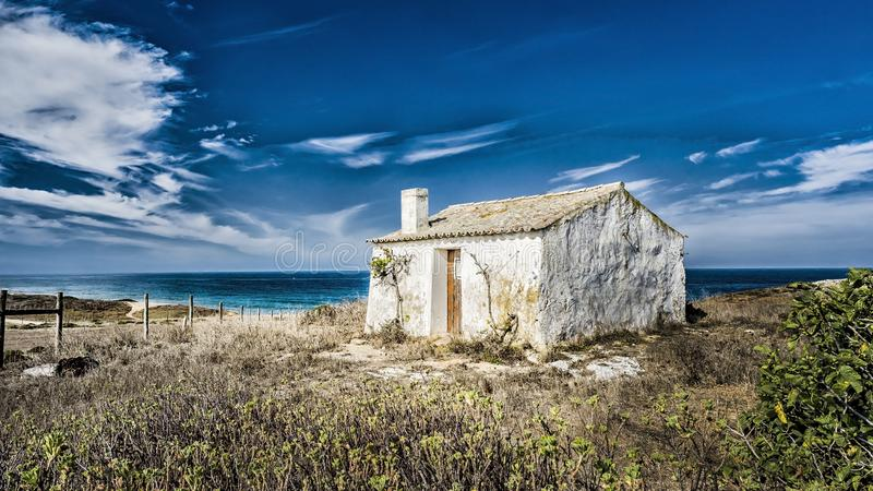 16:9 Dereliction with a view. Abandoned cottage situated on the hills near to beaches of Porto Covo. Portugal stock photography