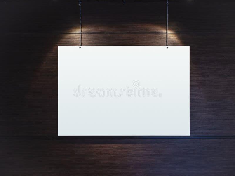 Derida sul manifesto che appende con la luce del punto sulla parete fotografia stock