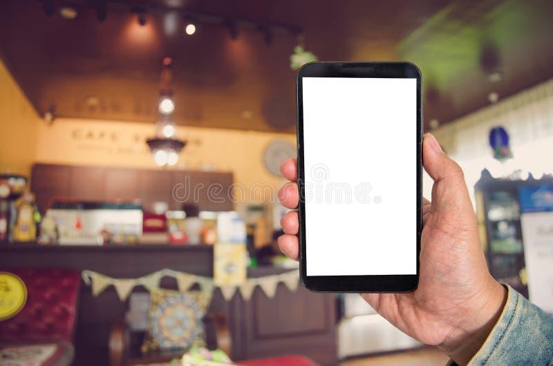 Derida sullo smartphone dello schermo in bianco nel fondo del centro commerciale della b fotografia stock