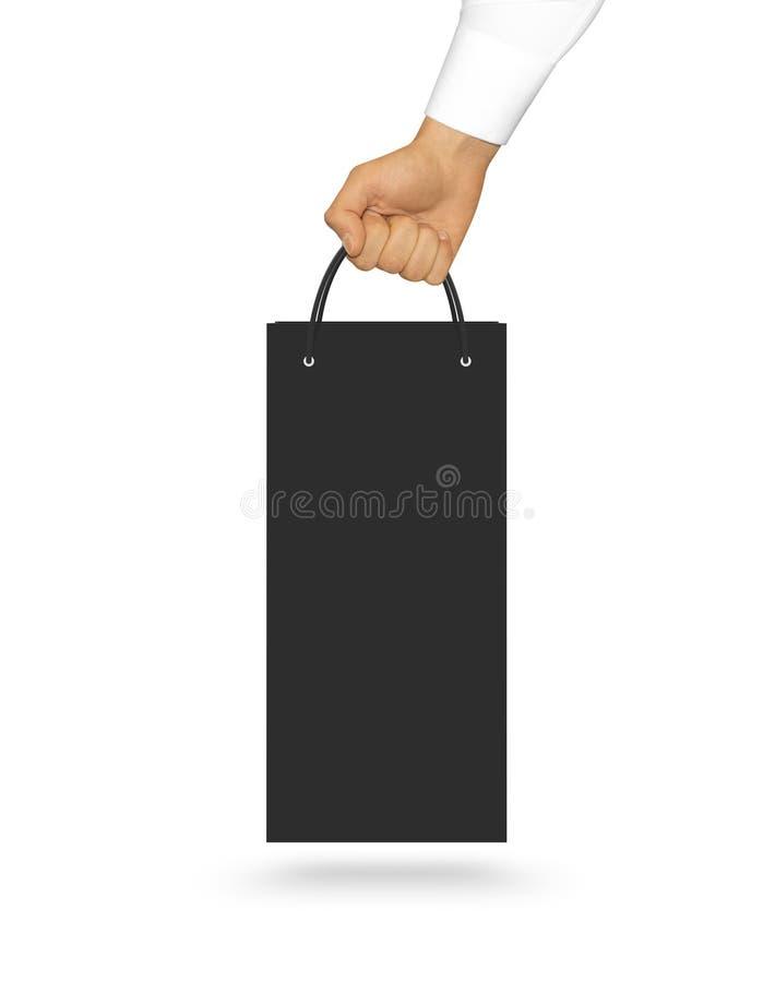 Derisione nera in bianco del sacco di carta del vino sulla tenuta a disposizione Plasti vuoto fotografia stock libera da diritti
