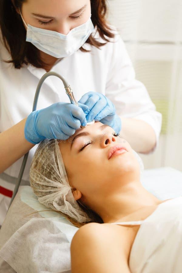 Dermabrasion face. Hardware cosmetology. stock image