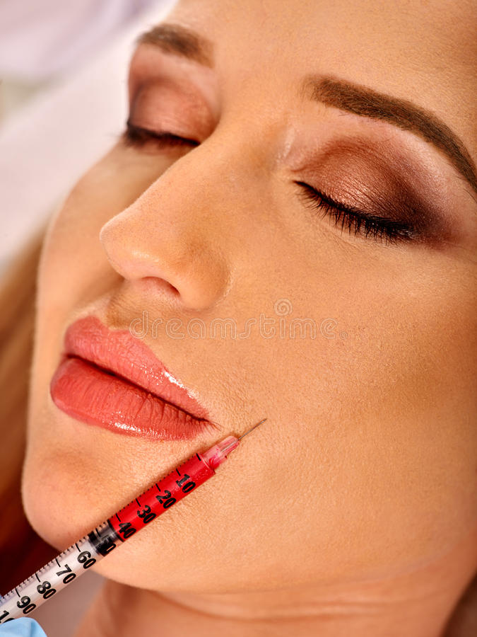 Dermal fillers of woman in spa salon with beautician. Filler injection for female forehead face. Plastic aesthetic facial surgery in beauty clinic. Beauty woman royalty free stock photography