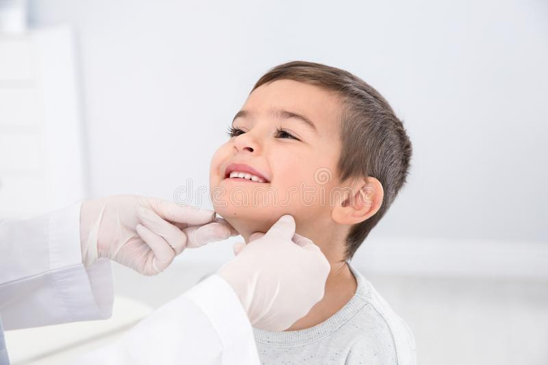 Dermatologist examining little boy`s birthmark. In clinic royalty free stock photo
