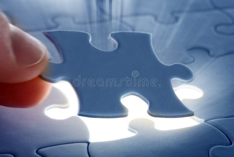 Dernière partie d'un puzzle photo stock