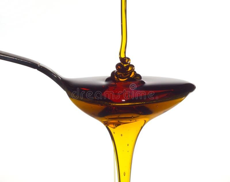 Derramamento do mel foto de stock