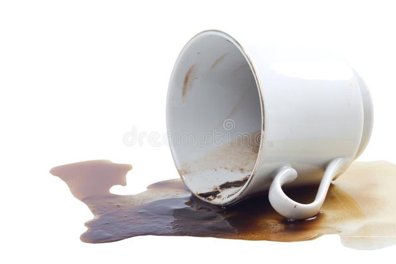 Derramamiento del café y una taza de café. foto de archivo libre de regalías