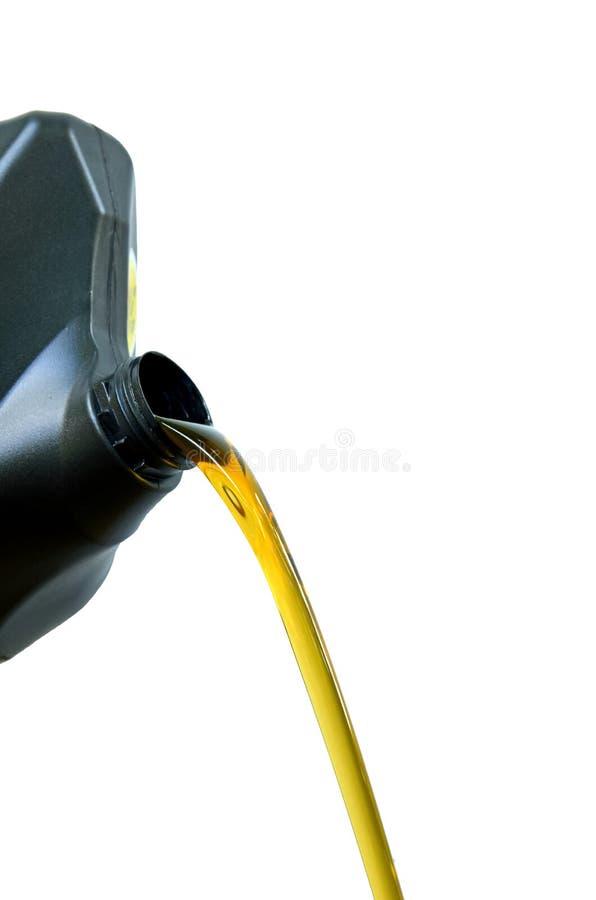 Derrame do óleo do preto dos galões Fundo branco fotos de stock