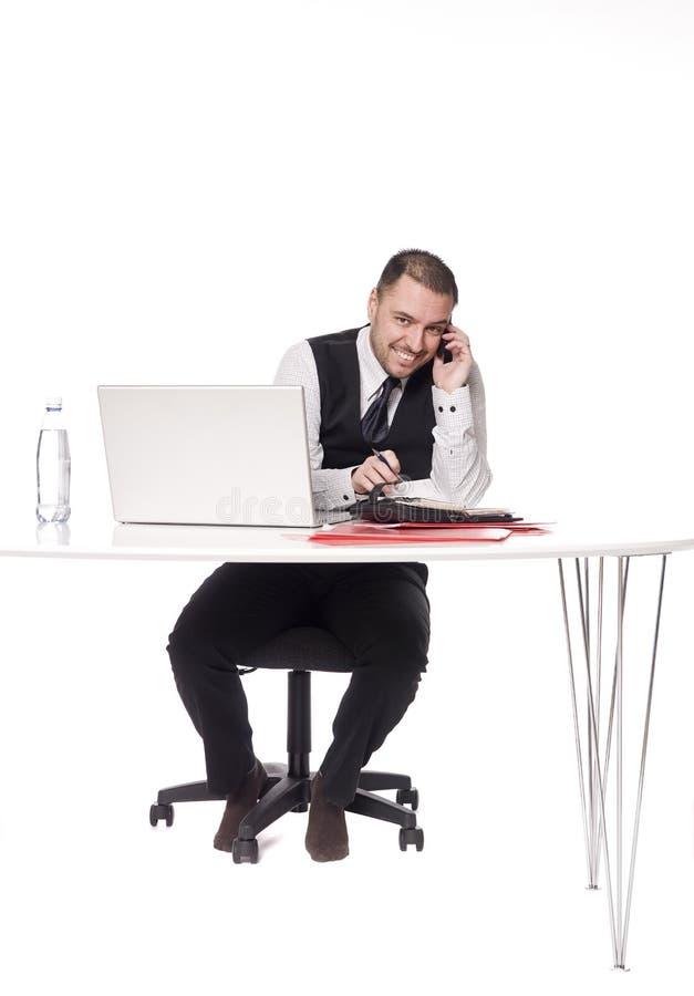 derrière l'homme de bureau image stock