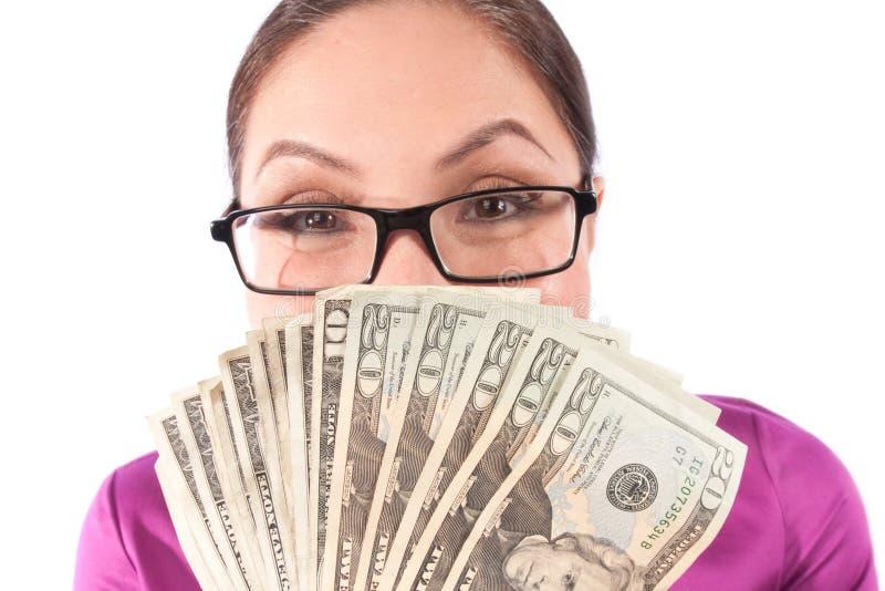 derrière la femme de dissimulation d'argent image libre de droits