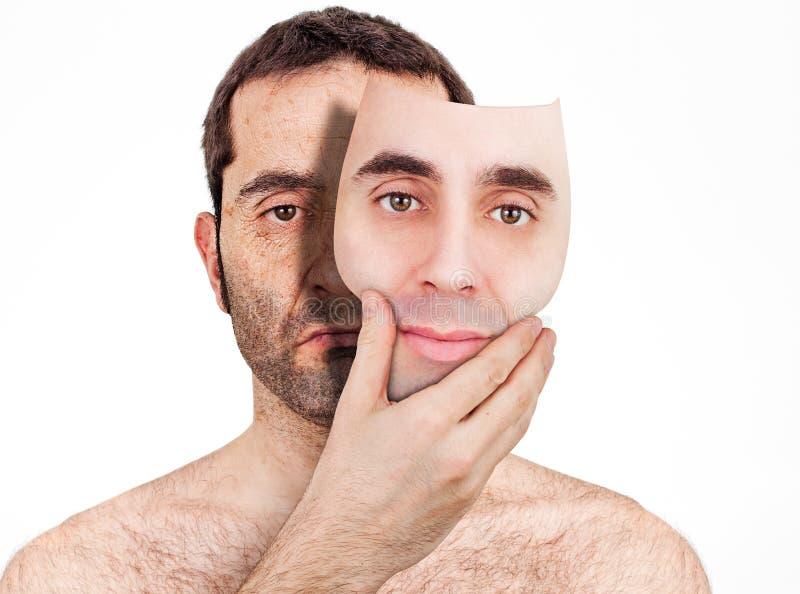 Derrière le masque photographie stock