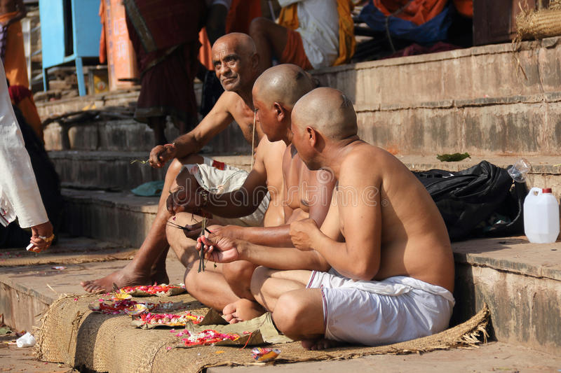 Dervish of Varanasi. This is three Hindu devotees are eating food, I always can't understand give up material desire of people here, need how powerful spiritual stock image
