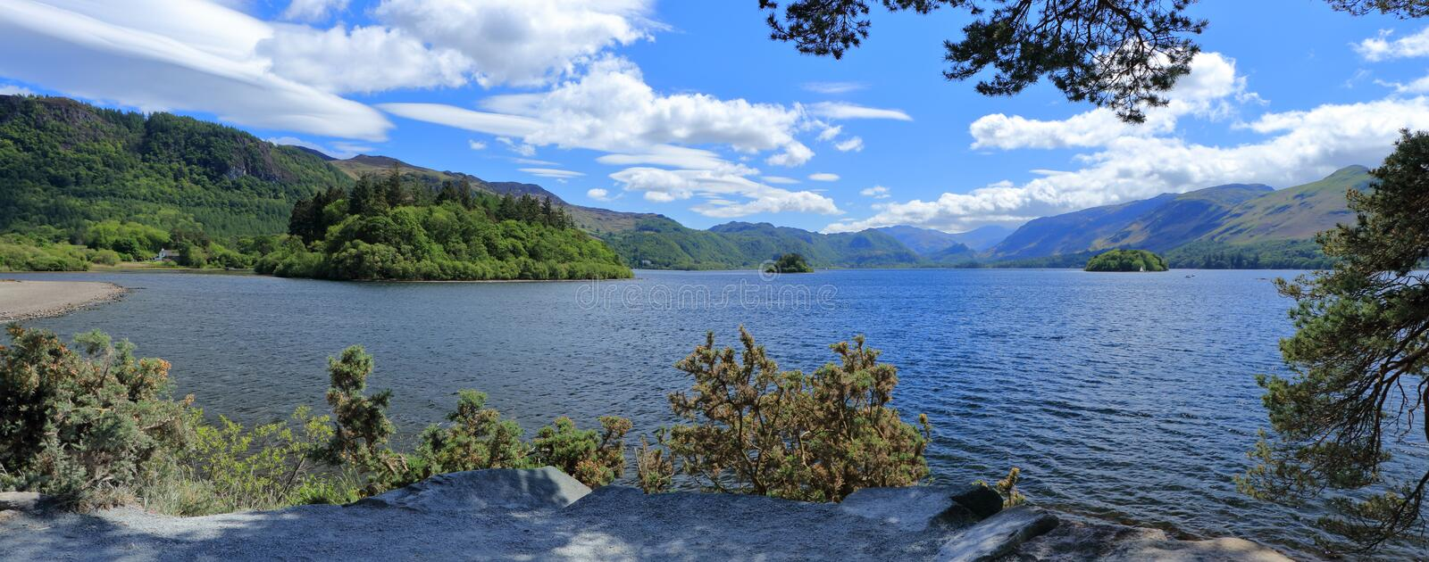 Panorama of Derwentwater near Keswick from Friars Crag with Islands and Mountain Views, Lake District National Park, Cumbria. The landscape panorama from Friars stock photos