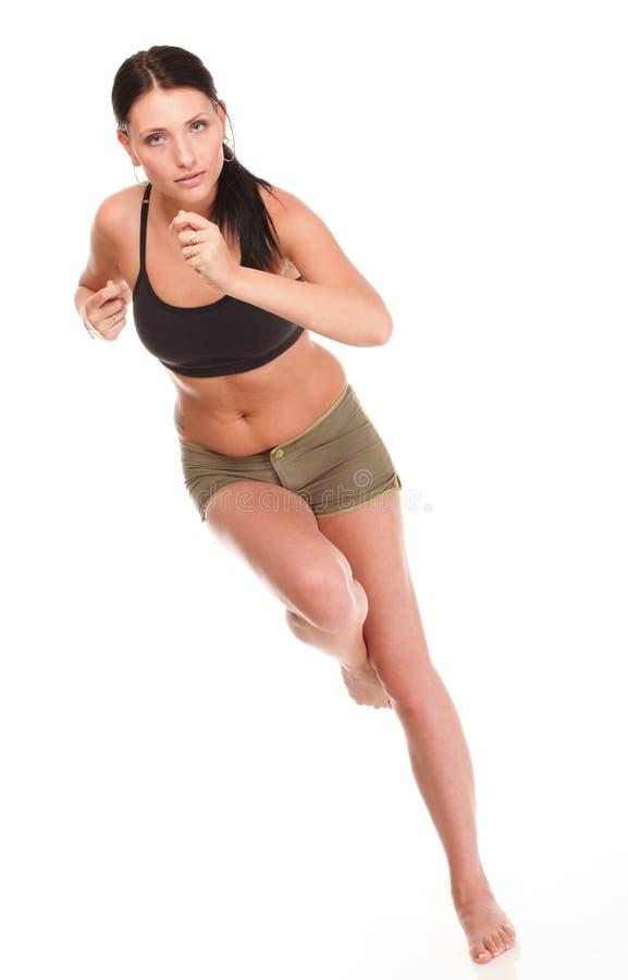 Des laufenden rüttelndes lächelndes glückliches Isolat Eignungs-Sports der Seitentriebsfrau lizenzfreie stockfotos