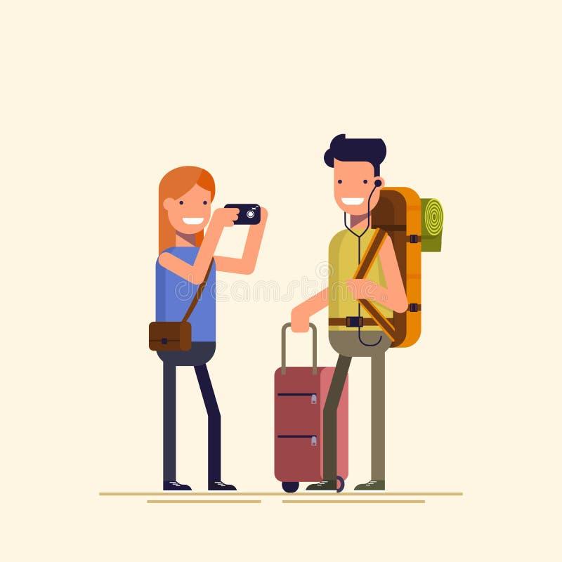 Des touristes sont photographiés Elle prend le type d'appareil-photo Jeune homme posant avec des paniers illustration libre de droits