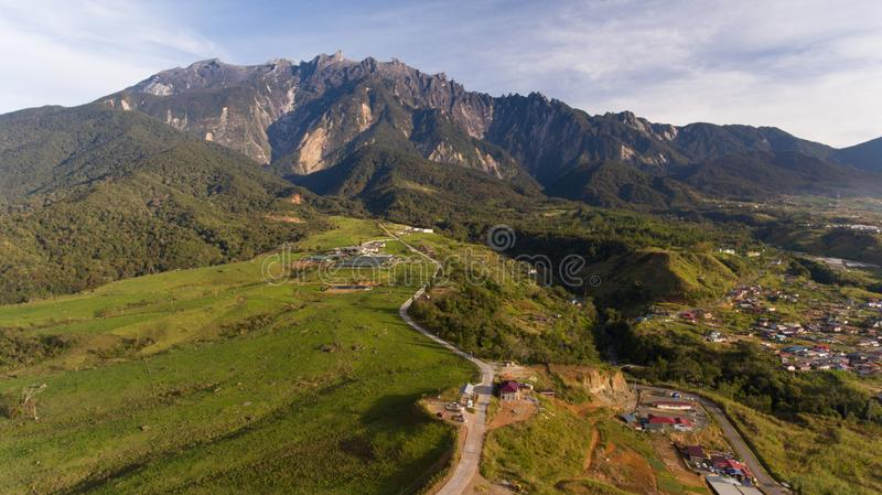 Desa Cattle Dairy Farm. An aerial view Desa Cattle Dairy Farm is a dairy farm located at the foot of Mount Kinabalu in Kundasang Valley, Sabah, Malaysia owned by stock photos