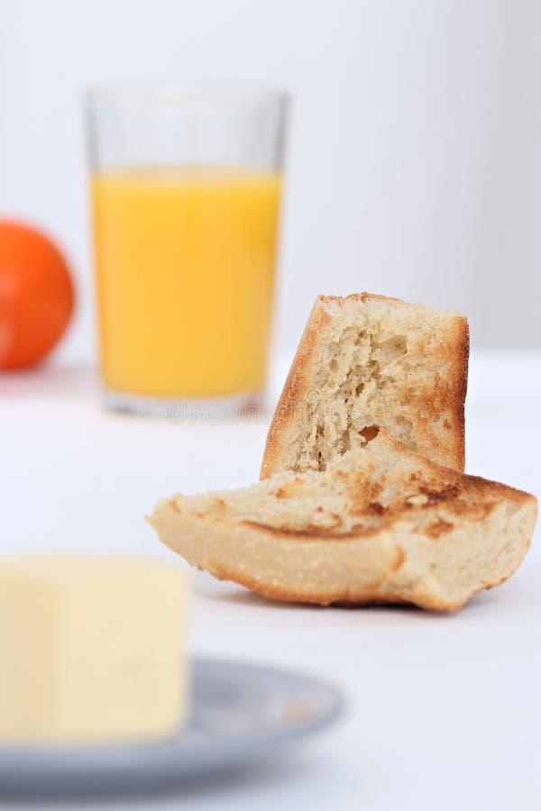 Desayuno con la tostada foto de archivo