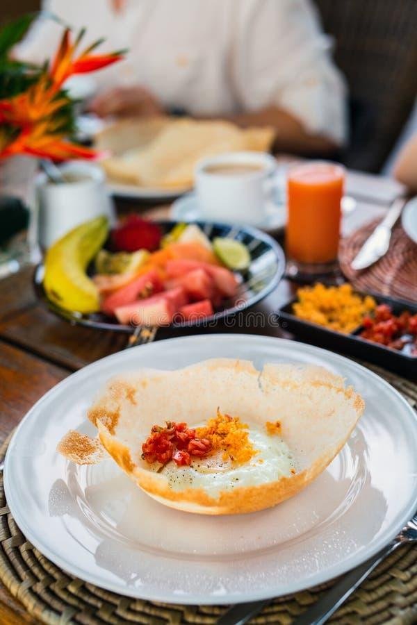 Desayuno del Sri Lankan de la tolva del huevo fotografía de archivo