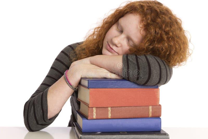Descanso de sono do estudante e do livro fotos de stock royalty free