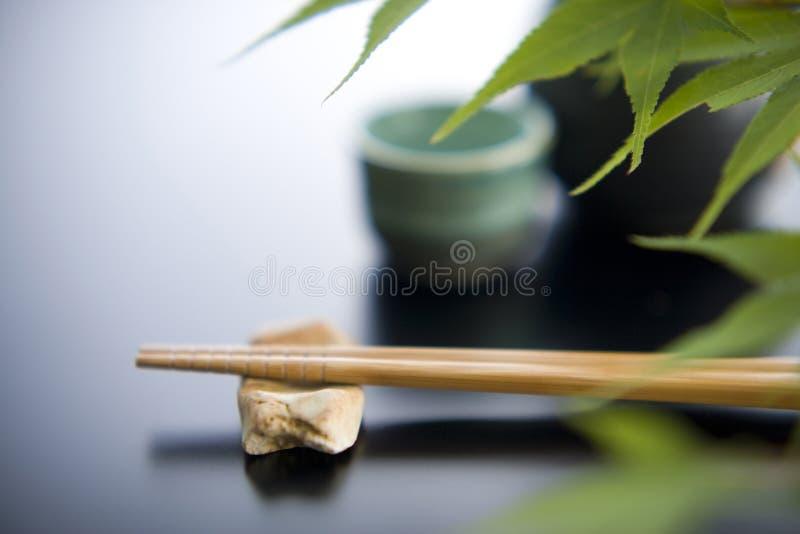 Descanso e chopsticks do Chopstick foto de stock royalty free