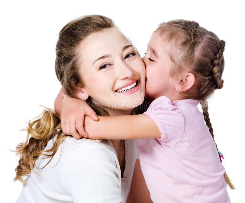 Descendant embrassant sa mère images stock
