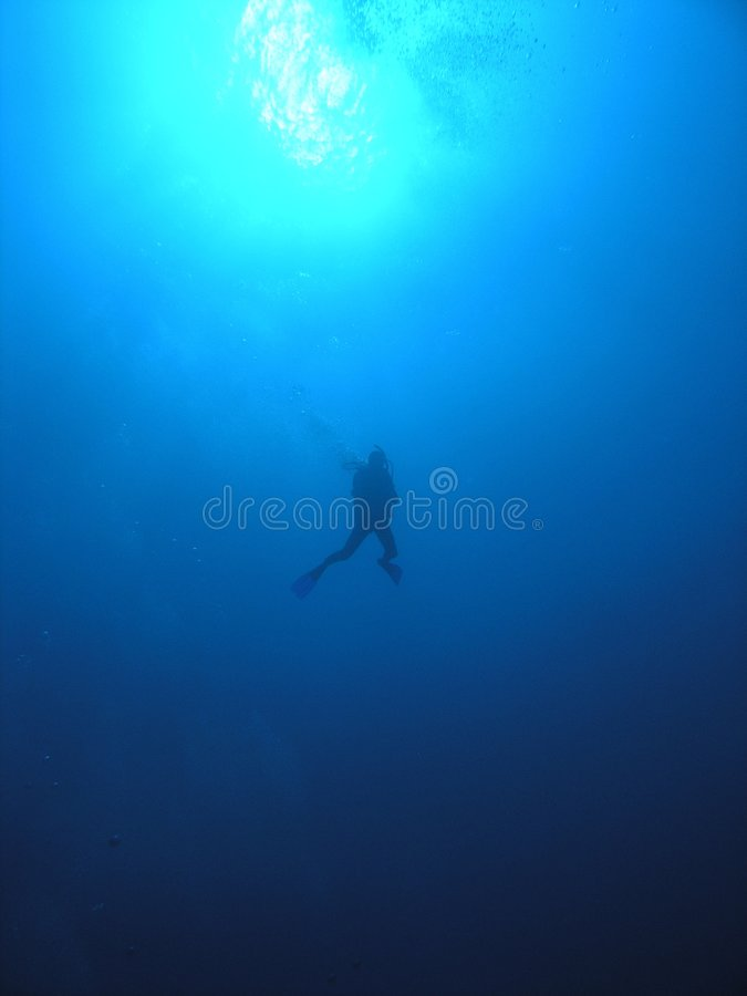 Descending Diver Into The Blue Royalty Free Stock Photography