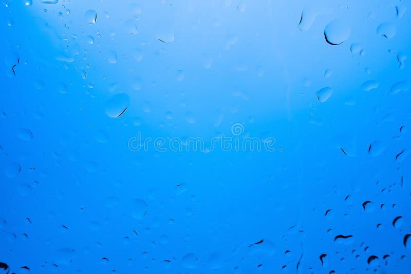 Descensos abstractos del agua azul fotografía de archivo