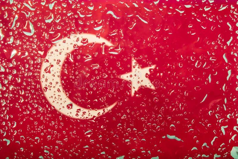 Descensos del agua en fondo turco de la bandera Profundidad del campo baja Foco selectivo entonado imágenes de archivo libres de regalías