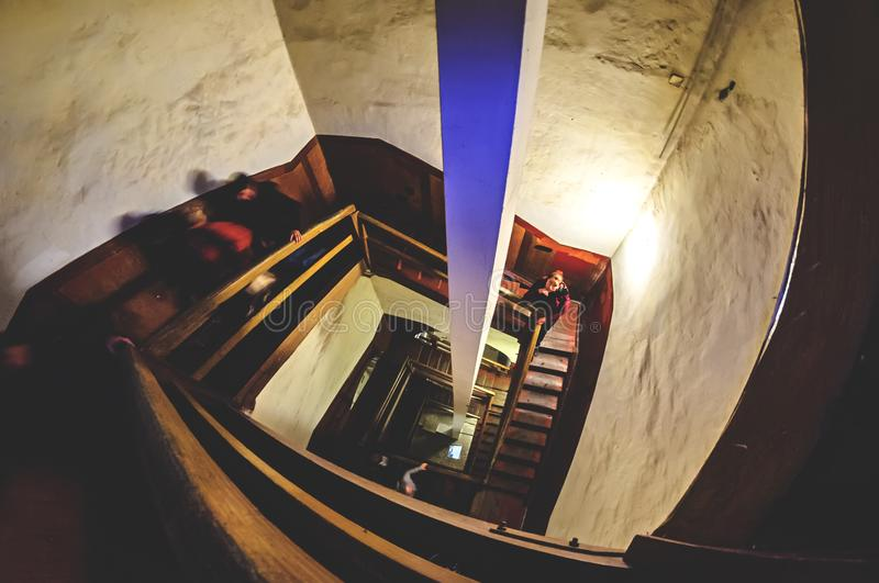 Descent down the spiral staircase. In the building of the Lviv City Hall royalty free stock photography