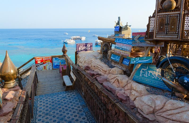 Descent down stairs to popular Farsha cafe with original design on shore of Red Sea in Hadaba district, Sharm El Sheikh, Egypt. SHARM EL SHEIKH, EGYPT stock image