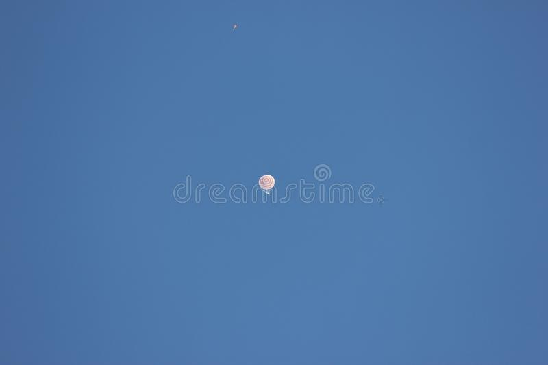 The descent module from the international space station on the main parachute. The crew of the Soyuz MS-08. Spacecraft was shot in the steppes of Kazakhstan stock image
